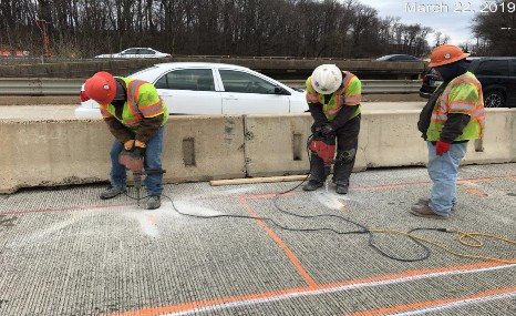 Drilling holes on Bridge 1017 to installed temporary plate clips.