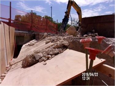 Demolishing section of backwall bridge 1017, abutment B, right of baseline.