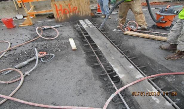 Reconstructing Strip Seal Joint at Span10/9, North Bridge.