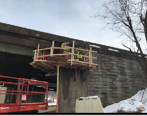 Contractor is Installing the handrails and mid rails for the scaffolding at Abutment A (1017) on S. capital St SB