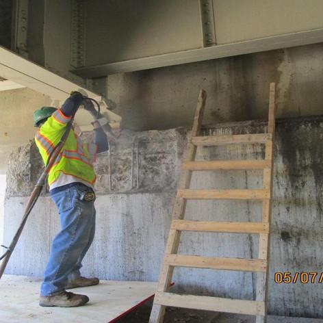 Repairing West Abutment Seat Wall, South Bridge.