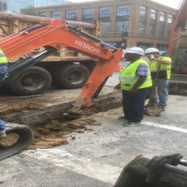 """Excavation for 4"""" and 2"""" PVC Conduit at the intersection of 14th and P Street"""