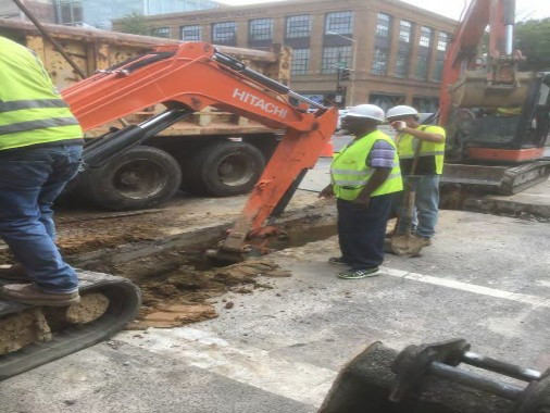 "Excavation for 4"" and 2"" PVC Conduit at the intersection of 14th and P Street"