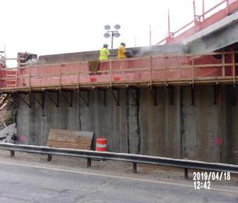 Sawcutting portion of existing backwall on bridge 1016 abutment B.