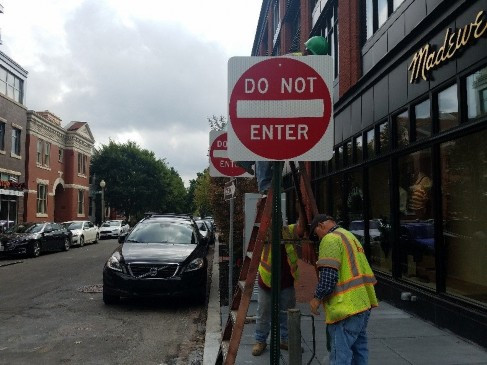 FMCC sign crew installing new signs at 14th & Wallach St