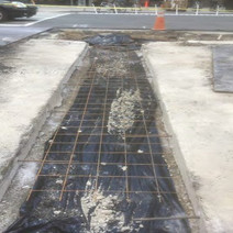 Wire mesh and Rebar prior to placement of PCC Base on Wallach St.