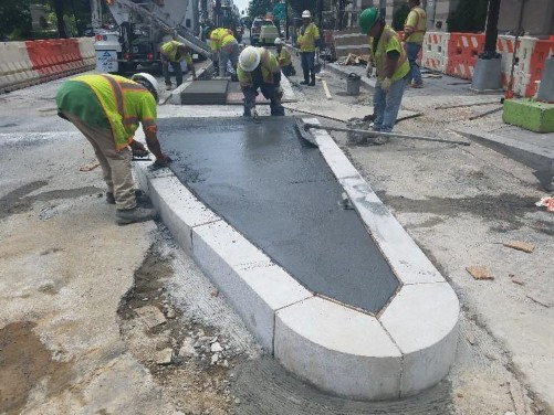 Granite curb installation at north section of bus island