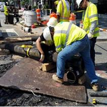 "Omni Excavators working on 8"" gate valve connection"