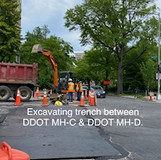 Excavating trench between DDOT MH-C & DDOT MH-D