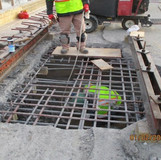 Removing Existing Scuppers, North Bridge.