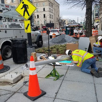FMCC electrical crew at NEC of 14th & Corcoran St installing flashing beacon system