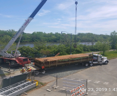 Unloading Barges into the Anacostia River, Southwest of the Bridge