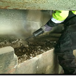 """Contractor is removing concrete by jack hummer on bearing area top of abutment """"B"""", 1017 SB"""