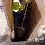 Dug test pit to located existing gas line