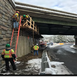 Contractor is installing bracket supported scaffolding in front of Abutment A (1016 NB) at South Capital St. SE