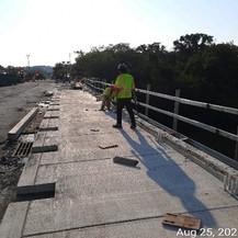 Stripping Sidewalk Formworks, South Bridge.