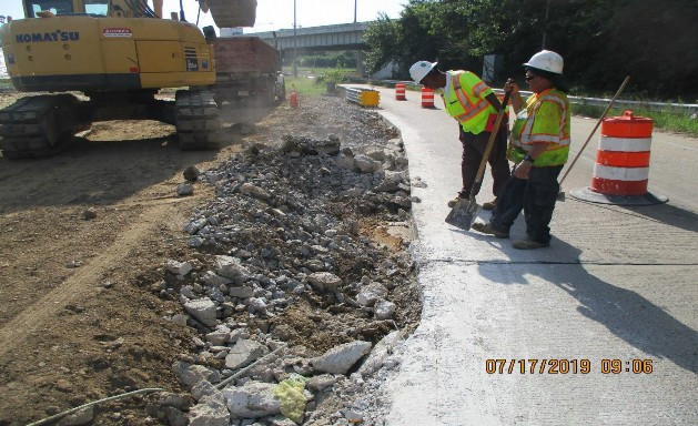 Removing Jersey Concrete Barrier at I-295N Ramp, East Side of the Bridge