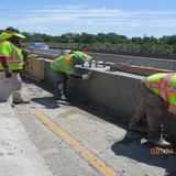 Finishing Median Barrier at Overhead Sign Structures.
