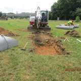 """Excavating to install 15"""" RCP Pipe and Flared End Section, Temporary Ramp A"""