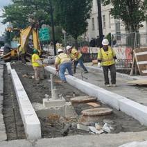 Granite curb being adjusted east as per drawings