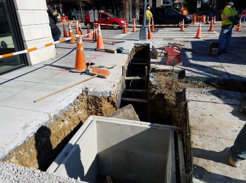 Installation of manhole at the NW Corner of W Street