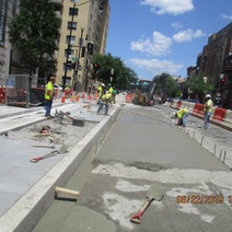 FMCC finishing up the concrete work for the installation of the Bus Pad at the southwest corner of 14th & N Street NW
