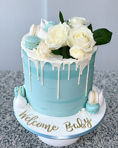 blue baby shower cake for boy white drip