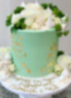 Engagement cake fresh flowers gold leaf