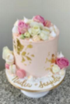 pink birthday cake macarons and flowers