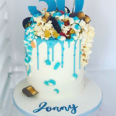 blue sweets and chocolateexplosion cake.