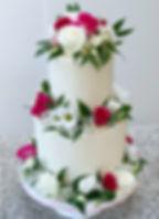 wedding cake fresh flowers hot pink and