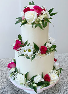 wedding cake fresh flowers hot pink and