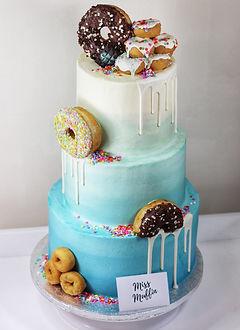 Unicorn cake rainbow vanilla layered tall gold