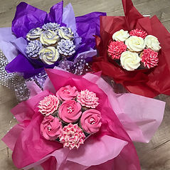 Pink and purple baby birthday girl cupcakes