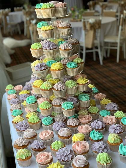 Pastel weding cake cupcake tower.jpg