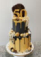 black and gold drip cake tiered 50th bir