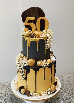 black and gold drip cake tiered 50th bir
