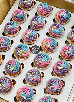 rainbow icing vanilla cupcakes .JPG