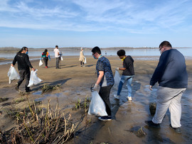 Change Makers pick up trash along the Hopewell River Walk.