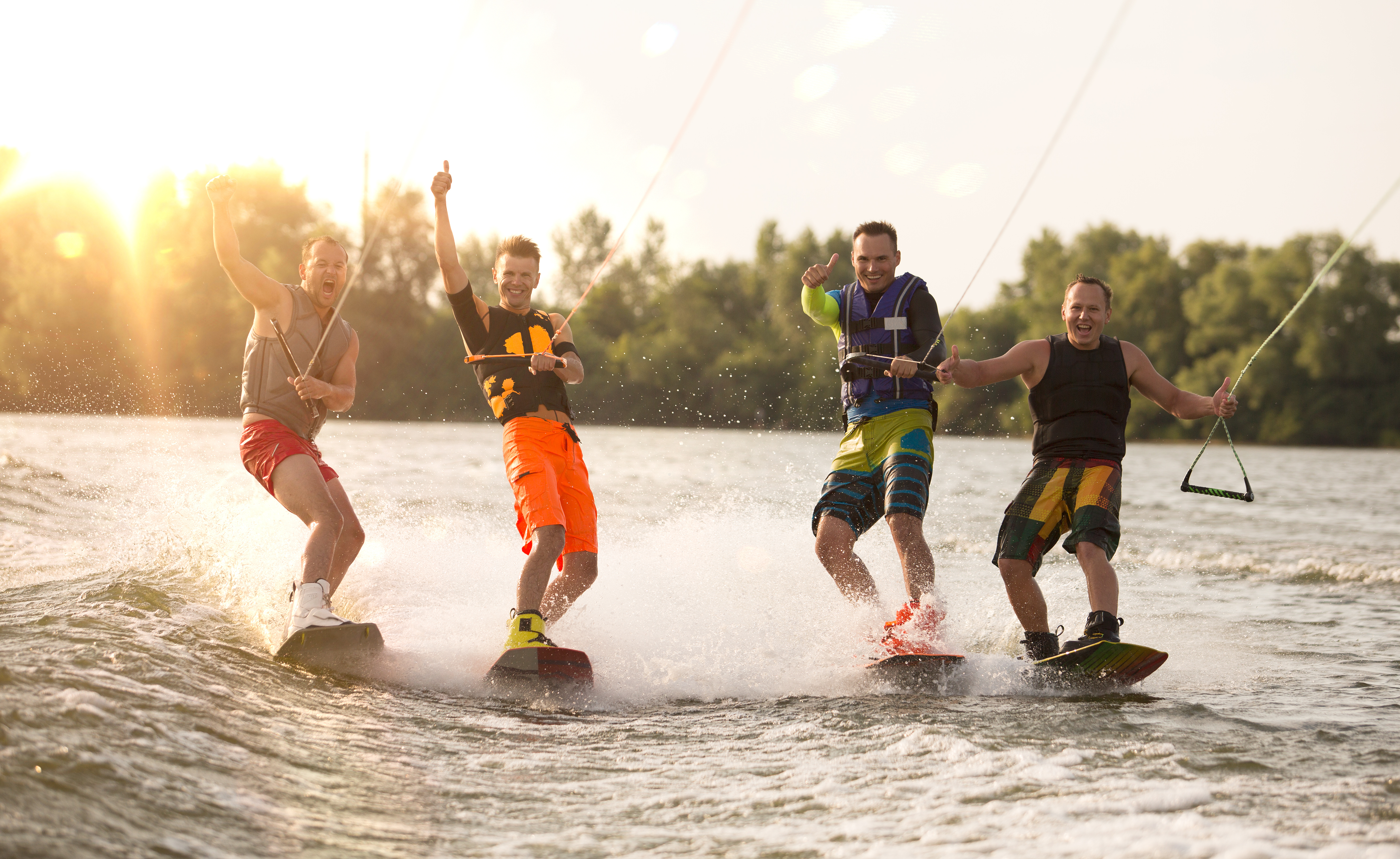 Four wake bord riders are having the fun