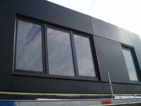 Dakbekleding in volkern en pvc raam