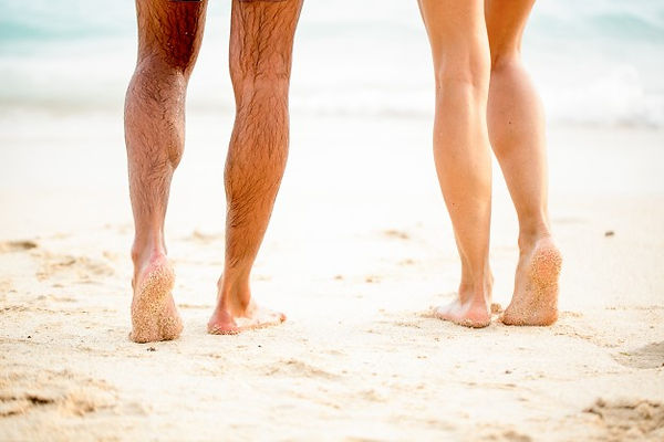 legs-young-couple-standing-beach-sand_12