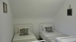 La chambre composée de 2 lits simple