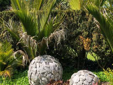 Two Teak Balls At The Entrance To The Oasis Garden