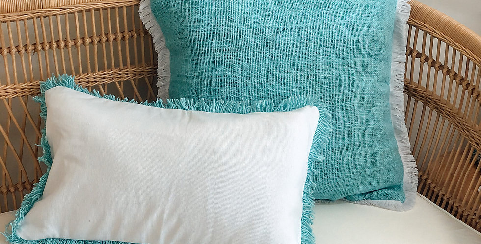 White Cushion With Aqua Fringing