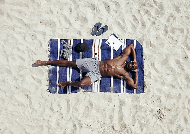 African Americn man enjoying beach
