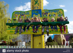 children-riding-on-a-fairground-ride-at-