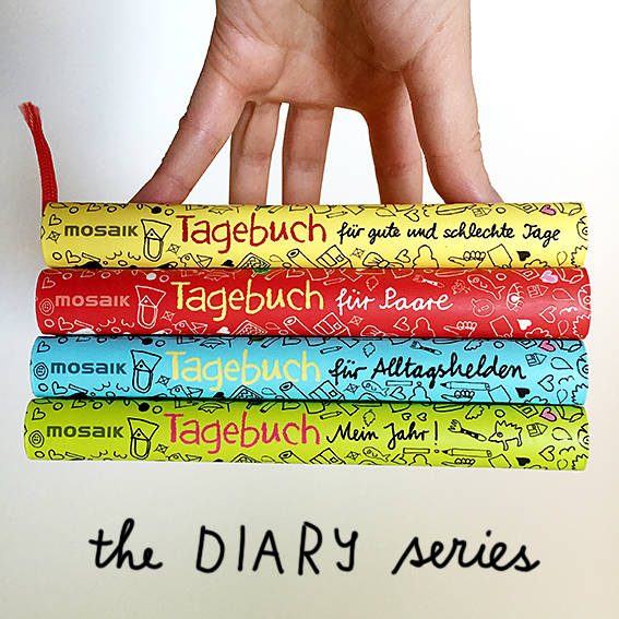 Hand holding stack of diaries