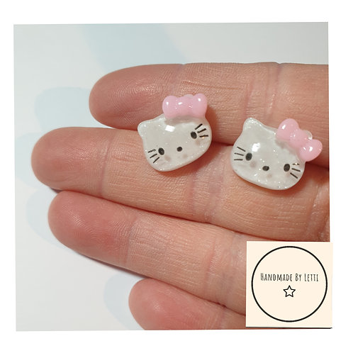 Resin cat stud earrings / clear glitter