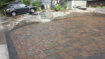 retaining wall steps interlock paver driveway gardens